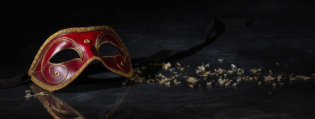 Carnival mask on black background, reflections, banner