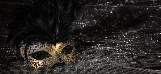 Carnival mask on black shiny background, banner