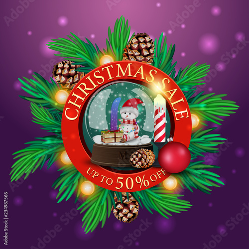 Round discount Christmas banner with Christmas tree branches, garland and snow globe with snowman