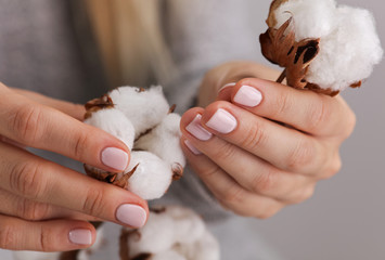 Female Manicure, natural look, nude color. Nails care.