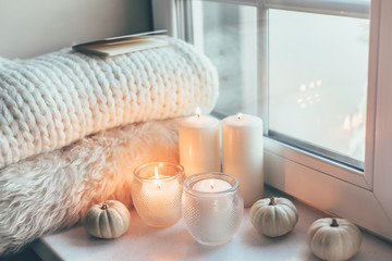 Hygge scene with sweater and candles