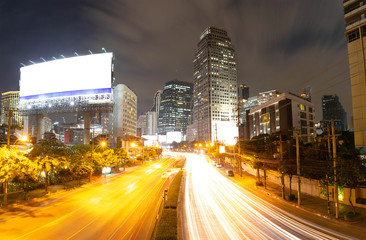 Motion light traffic on road With billboard and Cityscape