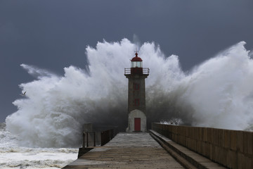 Big storm with big waves near a lighthouse Wall mural
