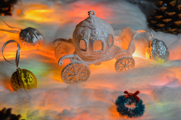 The staged picture is a fairytale carriage in the snow and three magic nuts. Fairy tale - three nuts for Cinderella and a pumpkin carriage.