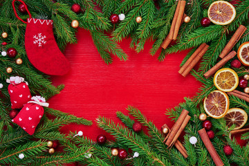Red Christmas background. Christmas tree branches, gifts and red Christmas socks. Copy space