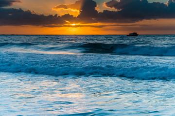 Sunrise Light and a Boat - Seascape