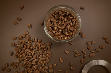 Crude pine nuts on brown background top view. Organic and healthy food.