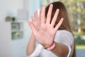 Fototapeta Woman showing stop gesture in office. Problem of sexual harassment at work obraz