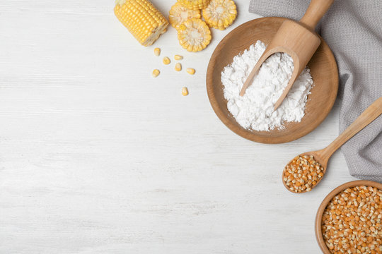 Flat lay composition with corn starch and space for text on white wooden background