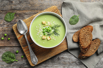 Fresh vegetable detox soup made of green peas served on table, top view