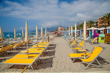Beach chair and colorful umbrella on the beach
