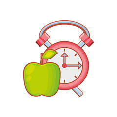 alarm clock with fresh apple fruit