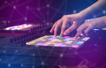 Hand remixing music on midi controller with colorful connectivity concept