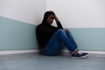 Depressed Man Sitting On Floor