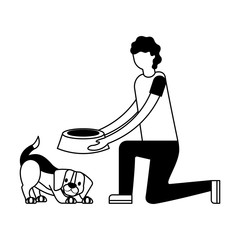 man giving food her dog