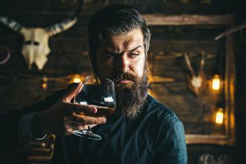Barman. Pub retro vintage interior. Hipster barman concept. Swag guy with alcohol. Drunk man. Whiskey, brandy, cognac concept.