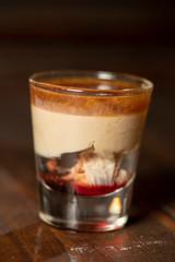 Brain Hemorrhage shot cocktail with schnapps, baileys irish cream and grenadine