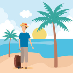 young man with suitcase on the beach