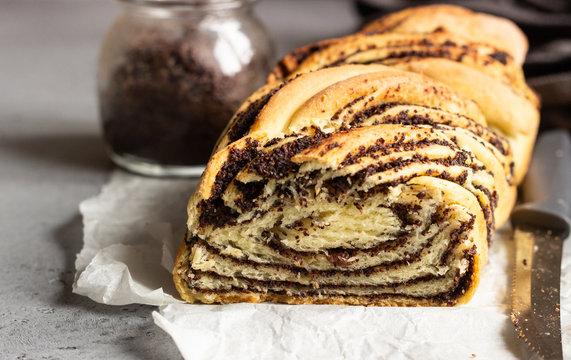 Swirl brioche with poppy seeds. Poppy seed braided or roll bread, Babka. Traditional Polish sweet Christmas bread.