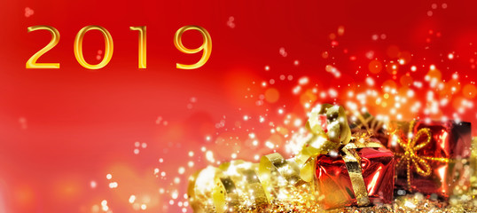 2019 new year  greeting card with christmas gifts on red background