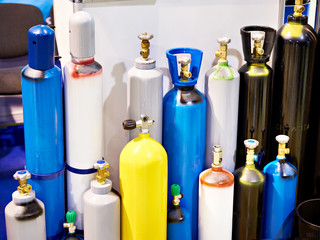 Metal cylinders for compressed gases