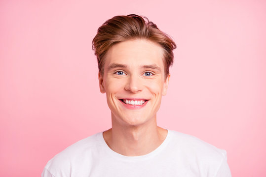 Close up portrait of man with beaming toothy white smile isolate