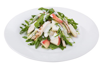 fitness salad of chicken, arugula and apple slices, with white sauce, on a plate, isolate