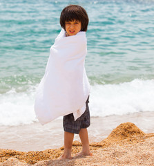 young swimmer wrapped in a towel