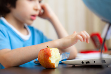 bitten apple and a boy with computer