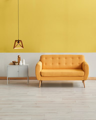 Modern yellow white wall yellow sofa with wooden lamp decor. Grey cabinet on the parquet interior room.