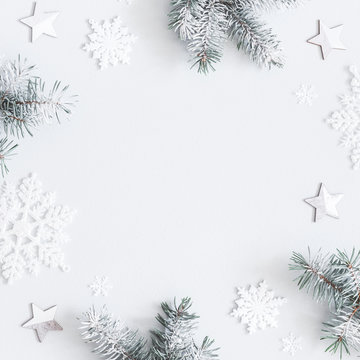 Christmas composition. Frame made of fir tree branches, decorations on pastel gray background. Christmas, winter, new year concept. Flat lay, top view, copy space, square