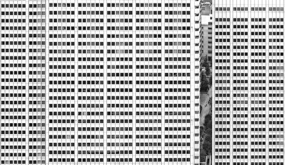 Deatail of Tokyo modern architecture , buildings facade with windows and street life across space between the skyscrapers   .