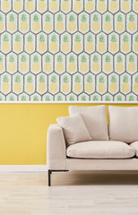 Sofa pineapple wallpaper and yellow wall concept interior.