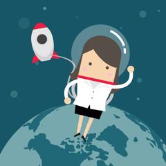 Businesswoman outside a rocket in space.