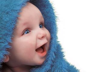 Smiling Happy Baby In Blue Blanket