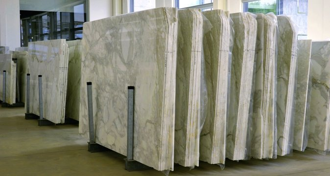 stacks of marble slab - marble industry factory, work marble in italy