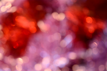 Bokeh photo. Holiday background. Christmas lights. Defocused sparkles. New Year backdrop. Festive wallpaper. Blinks. Carnival. Bokeh retro style photo. Pink.