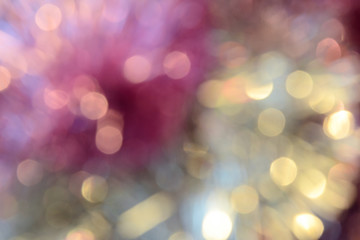 Bokeh photo. Holiday background. Christmas lights. Defocused sparkles. New Year backdrop. Festive wallpaper. Blinks. Carnival. Bokeh retro style photo. Pink.