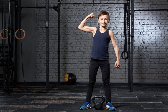 Training and sport. Kid in crossfit gym. Healthy lifestyle.