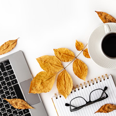 Workspace with laptop, coffee cup, glasses and notebook. Stylish office desk. Autumn concept. Flat lay, top view, copy space..