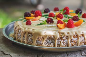 vegan raw cake with berries peach, mint and cashew cream