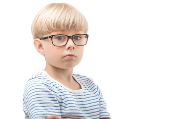 Cute little child on isolated background wearing eyeglasses. Cheerful kid with thumb up. Adorable boy