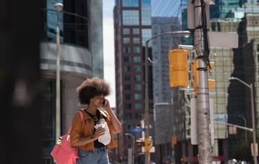 Woman talking on mobile phone in city