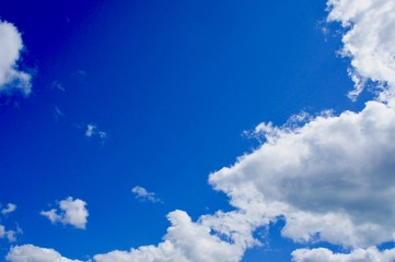 Blue Sky with Fluffy Cumulus Clouds and Copy Space