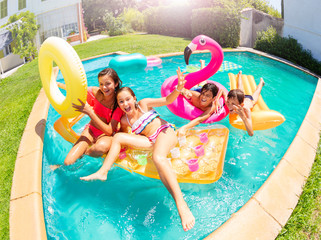 Happy teenagers having fun in swimming pool