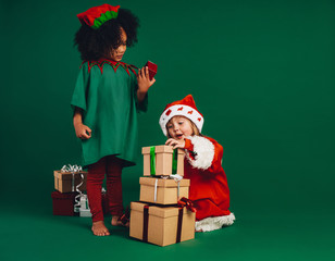 Kids playing with their christmas gifts