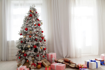 Christmas tree in the white room gifts new year Interior