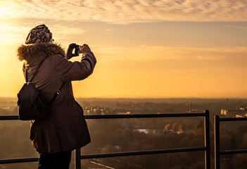 photographer at sunset. girl taking pictures