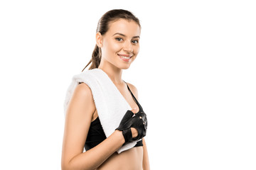 portrait of beautiful sportswoman in weightlifting gloves with white towel isolated on white