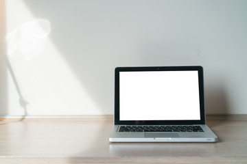 Laptop on a desk with lamp